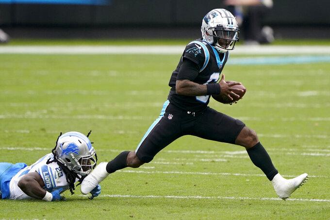 Carolina Panthers quarterback P.J. Walker breaks way from Detroit Lions cornerback Desmond Trufant during the first half of an NFL football game Sunday, Nov. 22, 2020, in Charlotte, N.C. (AP Photo/Brian Blanco)