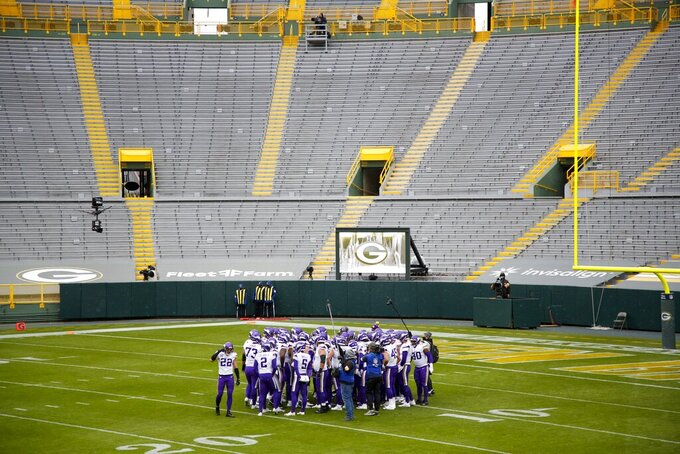 Minnesota Vikings players huddle before an NFL football game against the Green Bay Packers Sunday, Nov. 1, 2020, in Green Bay, Wis. (AP Photo/Matt Ludtke)