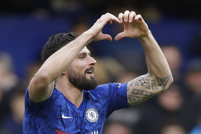 Chelsea's Olivier Giroud celbrates after scoring his side's fourth goal during the English Premier League soccer match between Chelsea and Everton at Stamford Bridge stadium in London, Sunday, March 8, 2020. (AP Photo/Matt Dunham)