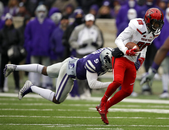 Texas Tech wide receiver Ja'Deion High (88) breaks away from Kansas State linebacker Da'Quan Patton (5) during the first half of an NCAA college football game in Manhattan, Kan., Saturday, Nov. 17, 2018. (AP Photo/Orlin Wagner)