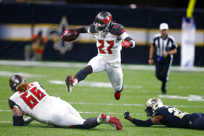 Tampa Bay Buccaneers defensive back Sean Murphy-Bunting (26) carries over center Ryan Jensen (66) and New Orleans Saints cornerback Eli Apple (25) in the first half of an NFL football game in New Orleans, Sunday, Oct. 6, 2019. (AP Photo/Butch Dill)