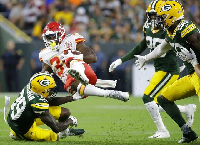 Kansas City Chiefs' Carlos Hyde is stopped by Green Bay Packers' Chandon Sullivan during the first half of a preseason NFL football game Thursday, Aug. 29, 2019, in Green Bay, Wis. (AP Photo/Mike Roemer)