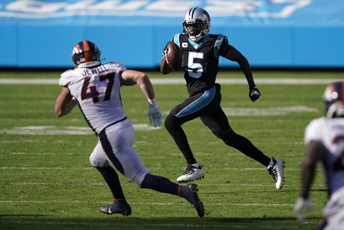 Carolina Panthers quarterback Teddy Bridgewater looks to run around Denver Broncos linebacker Josey Jewell during the first half of an NFL football game Sunday, Dec. 13, 2020, in Charlotte, N.C. (AP Photo/Gerry Broome)