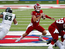 Fresno State quarterback Jake Haener looks to run as Hawaii linebacker Darius Muasau chases after during the first half of an NCAA college football game in Fresno, Calif., Saturday, Oct. 24, 2020. (AP Photo/Gary Kazanjian)