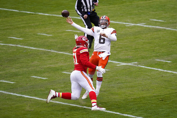 Cleveland Browns quarterback Baker Mayfield (6) throws a pass over Kansas City Chiefs defensive end Mike Danna during the first half of an NFL divisional round football game, Sunday, Jan. 17, 2021, in Kansas City. (AP Photo/Orlin Wagner)