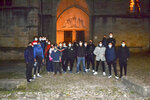This photo take on Oct. 29, 2020 shows a group of Muslim volunteers protecting the Saint-Fulcran cathedral In Lodeve, southern France. A group of French Muslims stood guard outside the Saint-Fulcran Cathedral in Lodeve for the All Saints' holiday, to protect it from eventual violence and show solidarity with Catholic churchgoers. Many welcomed the initiative, organized by local residents as a gesture of peace after a deadly Islamic extremist attack on a church in the French city of Nice. (Alain Mendez via AP)