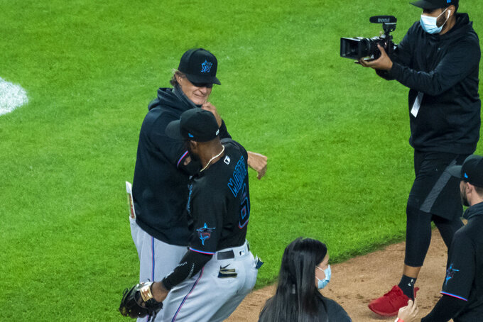 Miami Marlins manager Don Mattingly celebrates with the team in clinching a playoff berth after their win in the 10th inning of a baseball game against the New York Yankees at Yankee Stadium, Friday, Sept. 25, 2020, in New York. (AP Photo/Corey Sipkin)