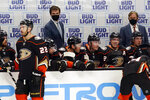 Anaheim Ducks head coach Dallas Eakins, top left, watches from the bench during the first period of an NHL hockey game against the Minnesota Wild, Monday, Jan. 18, 2021, in Anaheim, Calif. (AP Photo/Marcio Jose Sanchez)