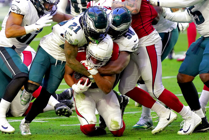 Arizona Cardinals wide receiver Larry Fitzgerald is tackled by Philadelphia Eagles strong safety Jalen Mills (21) and defensive end Genard Avery (58) during the first half of an NFL football game, Sunday, Dec. 20, 2020, in Glendale, Ariz. (AP Photo/Rick Scuteri)