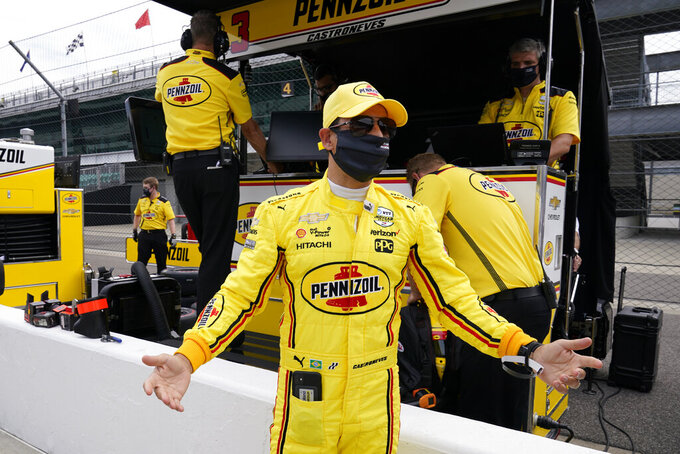 Helio Castroneves, of Brazil, reacts during a practice session for the Indianapolis 500 auto race at Indianapolis Motor Speedway, Wednesday, Aug. 12, 2020, in Indianapolis. (AP Photo/Darron Cummings)