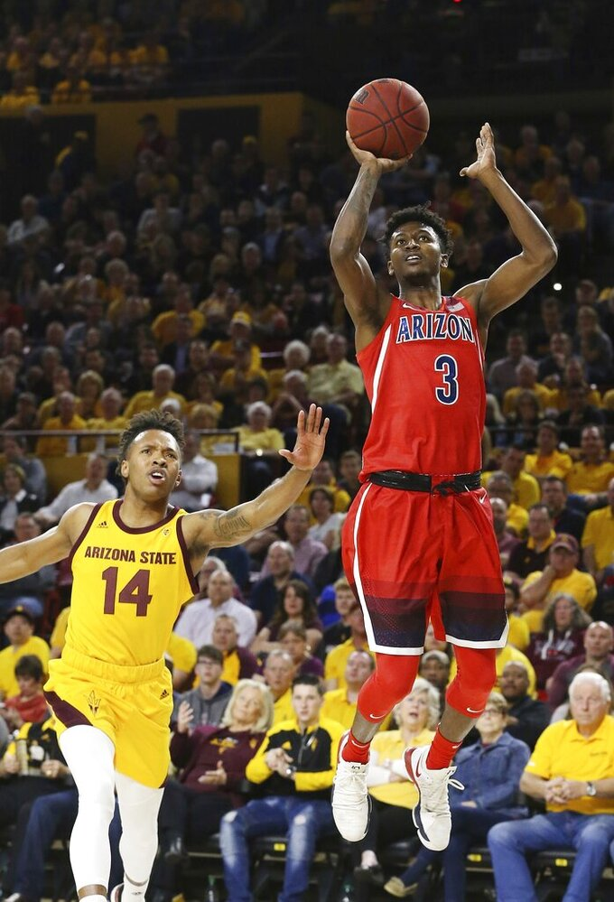Arizona guard Dylan Smith (3) drives past Arizona State forward Kimani Lawrence (14) during the first half of an NCAA college basketball game Thursday, Jan. 31, 2019, in Tempe, Ariz. (AP Photo/Ross D. Franklin)