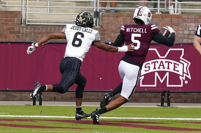 Mississippi State wide receiver Osirus Mitchell (5) avoids an attempted tackle by Vanderbilt cornerback Gabe Jeudy-Lally (6) on his way to a touchdown pass reception during the first half of an NCAA college football game in Starkville, Miss., Saturday, Nov. 7, 2020. (AP Photo/Rogelio V. Solis)