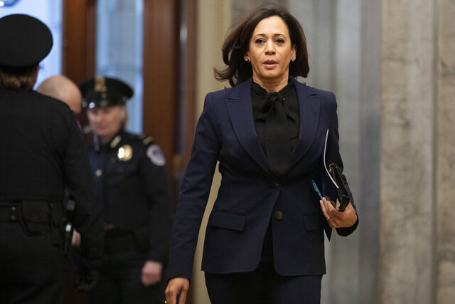 Sen. Kamala Harris, D-Calif., arrives on Capitol Hill in Washington, Friday, Jan. 31, 2020, for the impeachment trial of President Donald Trump on charges of abuse of power and obstruction of Congress. (AP Photo/ Jacquelyn Martin)