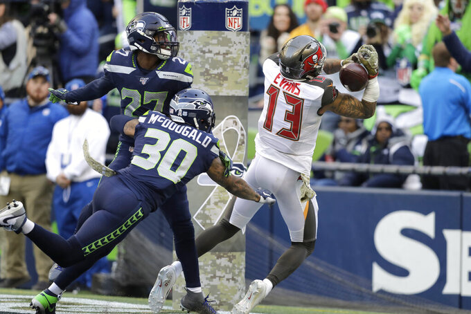 Seattle Seahawks strong safety Bradley McDougald (30) and defensive back Marquise Blair, left, look on as Tampa Bay Buccaneers wide receiver Mike Evans cannot hold on to a pass in the end zone during the second half of an NFL football game, Sunday, Nov. 3, 2019, in Seattle. (AP Photo/John Froschauer)
