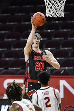 Utah's Mikael Jantunen, top, shoots over Southern California's Tahj Eaddy during the first half of an NCAA college basketball game, Saturday, Jan. 2, 2021, in Los Angeles. (AP Photo/Jae C. Hong)