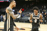 Atlanta Hawks forward John Collins (20) and guard Brandon Goodwin (0) celebrate after a 102-95 victory in an NBA basketball game against the Los Angeles Clippers, Wednesday, Jan. 22, 2020, in Atlanta. (AP Photo/Brett Davis)