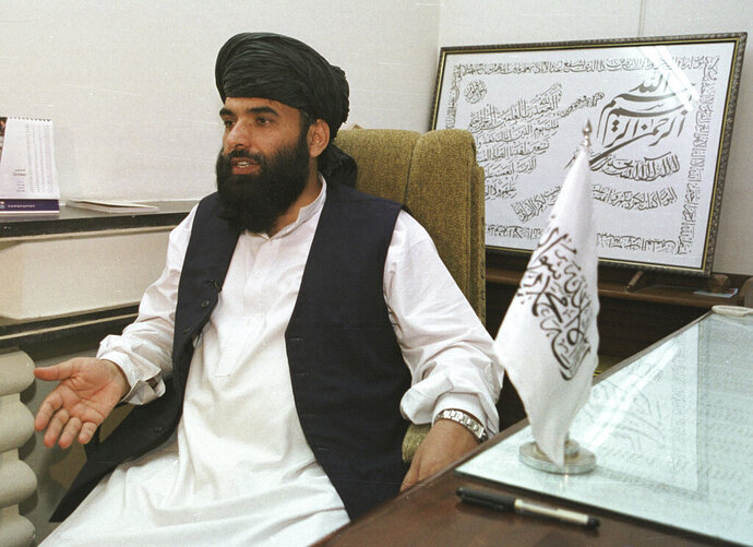 FILE - In this Nov. 14, 2001 file photo, Suhail Shaheen, then Deputy ambassador of the Islamic Republic of Afghanistan, gives an interview in Islamabad, Pakistan. The Taliban spokesman says the seventh and latest round of peace talks with the U.S. is
