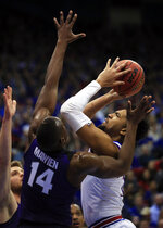 Kansas forward Dedric Lawson (1) shoots while covered by Kansas State forward Makol Mawien (14) during the first half of an NCAA college basketball game in Lawrence, Kan., Monday, Feb. 25, 2019. (AP Photo/Orlin Wagner)