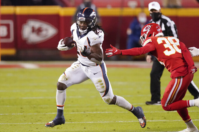 Denver Broncos running back Melvin Gordon (25) runs the ball as Kansas City Chiefs cornerback L'Jarius Sneed (38) defends in the first half of an NFL football game in Kansas City, Mo., Sunday, Dec. 6, 2020. (AP Photo/Charlie Riedel )