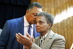 Rev. Jesse Jackson whispers to Chicago Mayor-elect Lori Lightfoot during a press conference at the Rainbow PUSH organization, Wednesday, April 3, 2019, in Chicago. (AP Photo/Nuccio DiNuzzo)