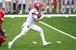 Rutgers quarterback Noah Vedral runs with the ball against Maryland during the first half of an NCAA college football game, Saturday, Dec. 12, 2020, in College Park, Md. (AP Photo/Julio Cortez)