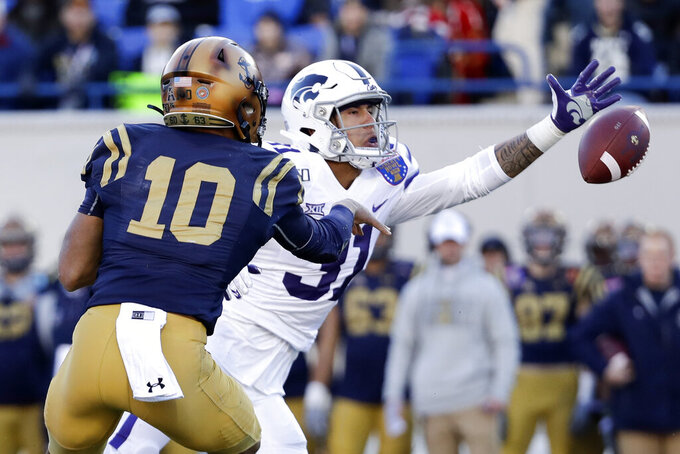 Kansas State defensive back Jahron McPherson (31) reaches for a pitchout from Navy quarterback Malcolm Perry (10) in the first half of the Liberty Bowl NCAA college football game Tuesday, Dec. 31, 2019, in Memphis, Tenn. (AP Photo/Mark Humphrey)