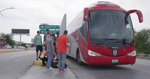 Members of the Tecolotes de los Dos Laredo, a binational professional baseball team with home stadiums in Nuevo Laredo, Mexico, and Laredo, Texas, board a bus in Nuevo Laredo to travel to an away game during the 2019 season in a scene from