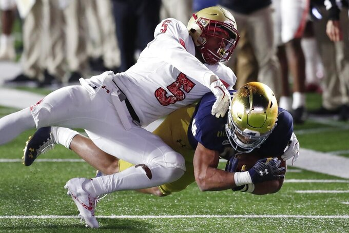 Boston College defensive back Deon Jones (5) tackles Notre Dame running back Chris Tyree during the second half of an NCAA college football game Saturday, Nov. 14, 2020, in Boston. (AP Photo/Michael Dwyer)