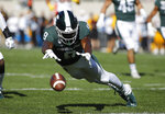 Michigan State's Dominique Long dives for the ball while attempting to down a punt during the first quarter of an NCAA college football game  against Arizona State, Saturday, Sept. 14, 2019, in East Lansing, Mich. The ball rolled into the end zone for a touchback. (AP Photo/Al Goldis)