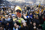 Appalachian State students and fans hold up a photo of Appalachian State head coach Eliah Drinkwitz following Appalachian State's 45-38 win over Louisiana-Lafayette in an NCAA college football game for the Sun Belt Football Championship on Saturday, Dec. 7, 2019, in Boone, N.C. (AP Photo/Brian Blanco)