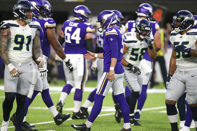 Minnesota Vikings kicker Dan Bailey, center, celebrates after making a 24-yard field goal during the first half of an NFL preseason football game against the Seattle Seahawks, Sunday, Aug. 18, 2019, in Minneapolis. (AP Photo/Jim Mone)