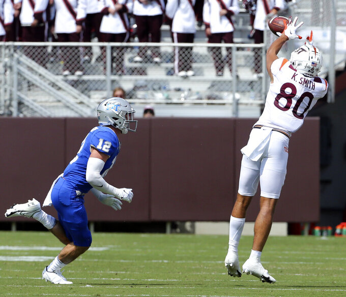 Virginia Tech wide receiver Kaleb Smith (80) catches a pass past Middle Tennessee safety Reed Blankenship (12) in the first half of an NCAA college football game, Saturday, Sept. 11, 2021, in Blacksburg Va.  (AP Photo/Matt Gentry)