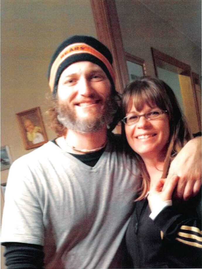 This undated photo provided by attorney Pressley Henningsen, shows Bronson Ganka and his wife, Kara, shortly before he died in 2014 after falling from a ladder while working in Iowa City, Iowa. Ganka's supervisor was ordered to pay $5.6 million Tuesday, Feb. 13, 2018, after a jury found that he was responsible for