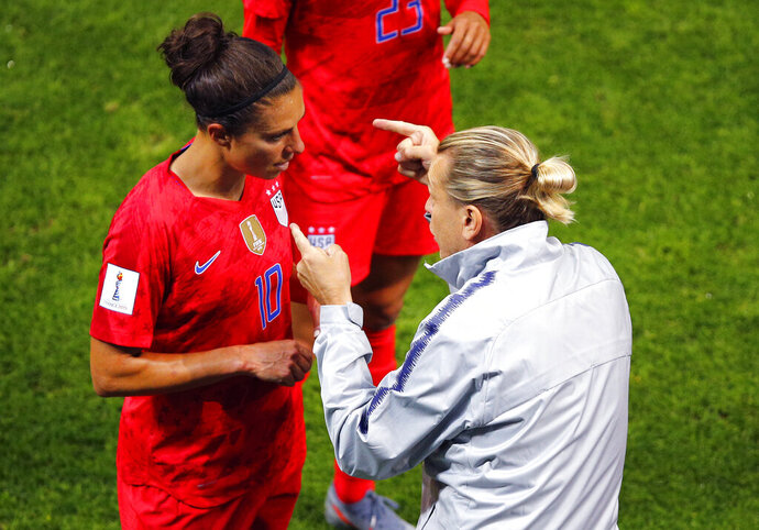 United States' coach Jill Ellis gestures as she talks to her player Carli Lloyd during the Women's World Cup Group F soccer match between the United States and Thailand at the Stade Auguste-Delaune in Reims, France, Tuesday, June 11, 2019. (AP Photo/Francois Mori)
