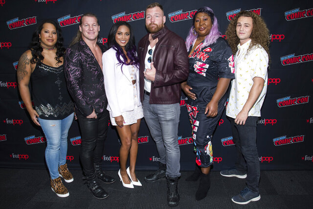 FILE - In this Friday, Oct. 4, 2019, file photo, Nyla Rose, from left, Chris Jericho, Brandi Rhodes, Jon Moxley, Awesome Kong and Jungle Boy attend New York Comic Con to promote TNT's