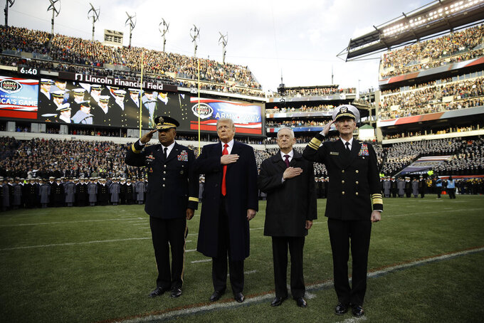 President Donald Trump, center left, and Secretary of Defense Jim Mattis, center right, stand for the national anthem before an NCAA college football between Army and Navy, Saturday, Dec. 8, 2018, in Philadelphia. (AP Photo/Matt Rourke)