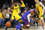 Iowa guard Joe Toussaint (1) steals the ball from DePaul forward Paul Reed during the second half of an NCAA college basketball game, Monday, Nov. 11, 2019, in Iowa City, Iowa. DePaul won 93-78. (AP Photo/Charlie Neibergall)