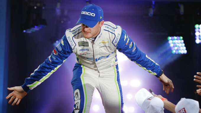 Ty Dillon greets fans during driver introductions for the NASCAR Monster Energy Cup series auto race at Richmond Raceway in Richmond, Va., Saturday, Sept. 21, 2019. (AP Photo/Steve Helber)