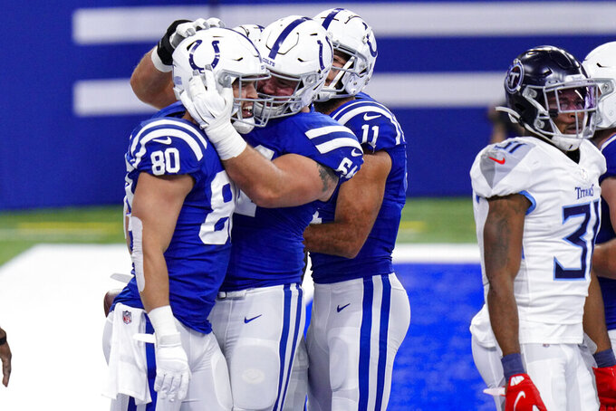 Indianapolis Colts tight end Trey Burton (80) celebrates a touchdown with offensive guard Mark Glowinski (64) in the first half of an NFL football game against the Tennessee Titans in Indianapolis, Sunday, Nov. 29, 2020. (AP Photo/AJ Mast)