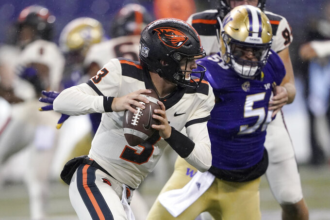 Oregon State quarterback Tristan Gebbia scrambles during the first half of the team's NCAA college football game against Washington, Saturday, Nov. 14, 2020, in Seattle. (AP Photo/Ted S. Warren)