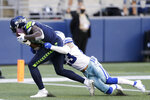Seattle Seahawks wide receiver DK Metcalf, left, catches a pass for a touchdown ahead of Dallas Cowboys strong safety Darian Thompson, right, during the second half of an NFL football game, Sunday, Sept. 27, 2020, in Seattle. (AP Photo/John Froschauer)