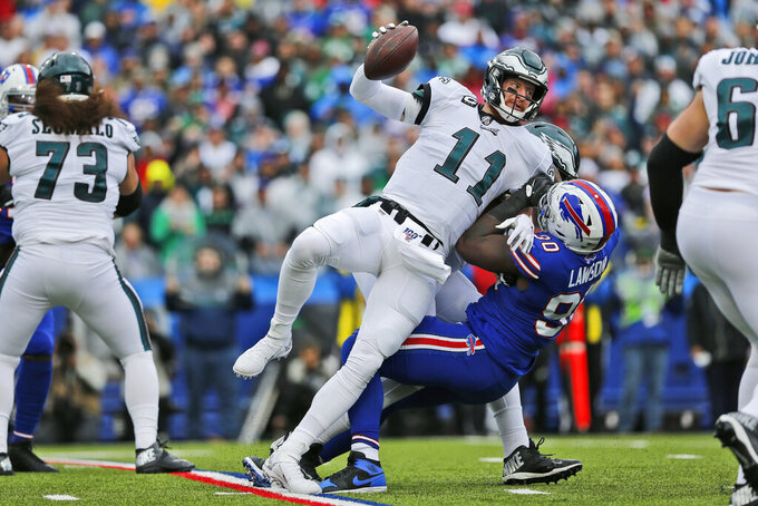 Philadelphia Eagles quarterback Carson Wentz (11) is sacked by Buffalo Bills' Shaq Lawson during the first half of an NFL football game, Sunday, Oct. 27, 2019, in Orchard Park, N.Y. (AP Photo/John Munson)