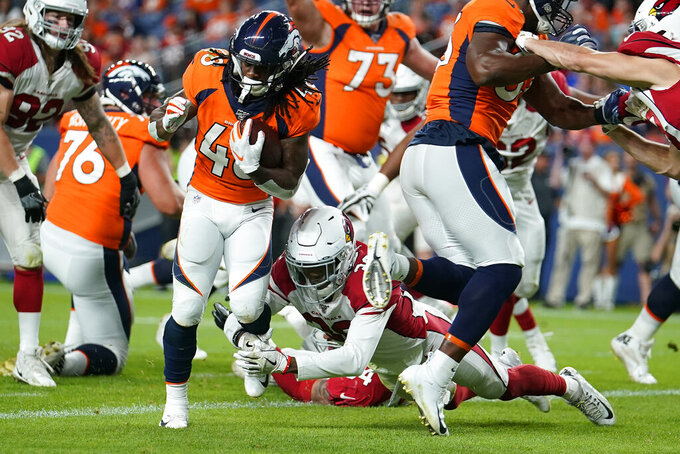 Denver Broncos running back Devontae Jackson (48) scores a touchdown as Arizona Cardinals defensive back Jalen Thompson defends during the second half of an NFL preseason football game, Thursday, Aug. 29, 2019, in Denver. (AP Photo/Jack Dempsey)