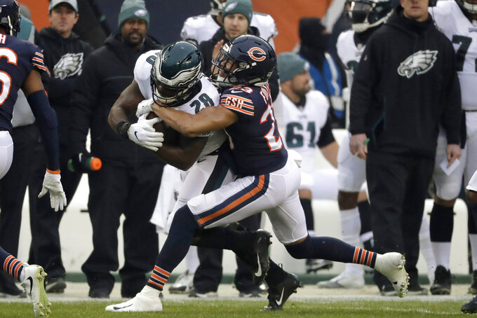 Chicago Bears cornerback Kyle Fuller (23) tackles Philadelphia Eagles running back Wendell Smallwood (28) during the first half of an NFL wild-card playoff football game Sunday, Jan. 6, 2019, in Chicago. (AP Photo/Nam Y. Huh)