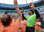 "Carolina Panthers Cam Newton, right, celebrates as participants sing ""Happy Birthday"" during his charity kickball tournament in Charlotte, N.C., Friday, May 10, 2019. Both Panthers QBs will be action Friday. Cam Newton will be on the field at Bank of America Stadium throwing balls _ kickballs, that is _ as part of his annual Kicking it with Cam Kickball Tournament. Meanwhile rookie draft pick QB Will Grier will throwing footballs for the first time as Carolina opens rookie minicamp on the team's practice fields outside the stadium. (AP Photo/Chuck Burton)"