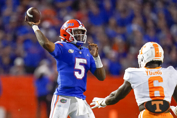Florida quarterback Emory Jones (5) throws a pass over Tennessee linebacker Byron Young (6) during the first half of an NCAA college football game, Saturday, Sept. 25, 2021, in Gainesville, Fla. (AP Photo/John Raoux)