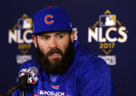 FILE - In this Oct. 17, 2017, file photo, Chicago Cubs' Jake Arrieta talks during a news conference before Game 3 of baseball's National League Championship Series against the Los Angeles Dodgers, in Chicago. Perhaps 100 free agents still seek contracts as the start of spring training workouts on Feb. 14 draws near, a group that includes J.D. Martinez, Eric Hosmer, Mike Moustakas, Jake Arrieta and Yu Darvish. (AP Photo/Charles Rex Arbogast, File)