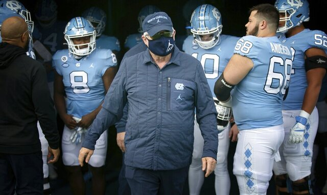 North Carolina coach Mack Brown enters the field prior to and NCAA college football game against Western Carolina on Saturday, Dec. 5, 2020 at Kenan Stadium in Chapel Hill, N.C. (Robert Willett/The News & Observer via AP)