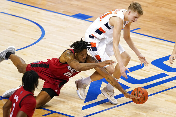 Syracuse forward Marek Dolezaj, top, and North Carolina State forward Manny Bates (15) chase the ball during the second half of an NCAA college basketball game in the second round of the Atlantic Coast Conference tournament in Greensboro, N.C., Wednesday, March 10, 2021. (AP Photo/Gerry Broome)