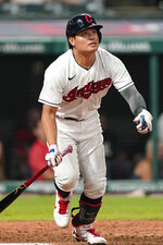 Cleveland Indians' Yu Chang watches his RBI double during the sixth inning of the team's baseball game against the Texas Rangers, Wednesday, Aug. 25, 2021, in Cleveland. (AP Photo/Tony Dejak)